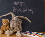 Handwriting message on chalk board with felt doll Royalty Free Stock Photography