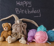 Handwriting message on chalk board with felt doll Royalty Free Stock Image