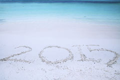 Handwriting of number 2015 on sand Stock Image