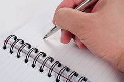 Handwriting with pen on the notebook Royalty Free Stock Image