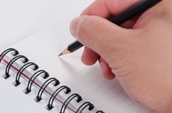 Handwriting with pencil on the notebook Royalty Free Stock Photos