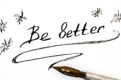 Handwriting phrase Be Better with pen. Close-up Stock Photo