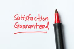 Handwriting of satisfaction guarantee. With red color pen royalty free stock photography