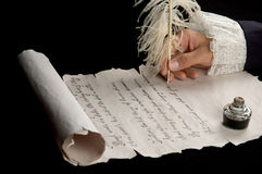 Handwriting on scroll paper. Handwriting with feather pen on antique scroll paper Stock Image