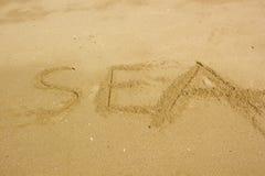 Handwriting Sea on the beach Stock Photos