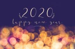 Handwriting 2020 szczęśliwych nowy rok na rocznik plamy bokeh światła świątecznym tle, wakacyjna kartka z pozdrowieniami fotografia royalty free