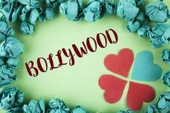 Handwriting tekst Bollywood Pojęcia znaczenia Indiański kino źródło pisać na prostym tle wśród Papierowych piłek rozrywka zdjęcie stock