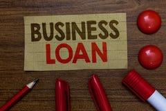 Handwriting tekst pisze Biznesowej pożyczce Pojęcia znaczenia kredyta hipoteki pomocy finansowej Gotówkowych postępów długu Paper obrazy royalty free