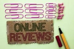 Handwriting tekst pisze Online przeglądach Pojęcia znaczenia cenień klienta Internetowa ocena Opiniuje satysfakcję pisać na herba obraz stock