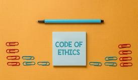 Handwriting teksta kodeks etyczny Pojęcie znaczy podstawowego przewdonika dla fachowego zachowania i narzuca obowiązek Barwiącego zdjęcie royalty free