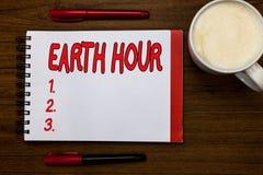 Handwriting teksta writing ziemi godzina Pojęcie znaczy Globalnego ruchu wezwanie dla wielkiej akci na zmianie klimatu Otwartej zdjęcie stock