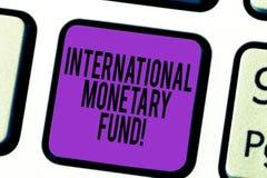 Handwriting teksta zawody międzynarodowi fundusz monetarny Pojęcia znaczenie promuje międzynarodowej pieniężnej stabilności Klawi zdjęcie stock