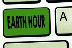 Handwriting teksta ziemi godzina Pojęcie znaczy Globalnego ruchu wezwanie dla wielkiej akcji na zmiana klimatu zdjęcia royalty free