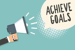 Handwriting text Achieve Goals. Concept meaning Results oriented Reach Target Effective Planning Succeed Man holding megaphone lou. Dspeaker speech bubble blue stock illustration