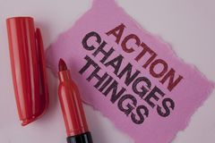 Handwriting text Action Changes Things. Concept meaning doing something is like chain Improve Reflects written on Tear Pink Sticky. Handwriting text Action stock photos