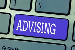 Handwriting text Advising. Concept meaning Give advice recommendation assistance professional support.  stock photography