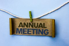 Handwriting text Annual Meeting. Concept meaning Yearly Company Assembly Business Conference Report Event written on Cardboard Pap. Handwriting text Annual stock photos