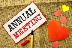 Handwriting text Annual Meeting. Concept meaning Yearly Company Assembly Business Conference Report Event written on Sticky Note P. Handwriting text Annual stock image