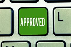 Handwriting text Approved. Concept meaning Approval Permission to do something Confirmation document.  stock photography