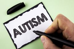 Handwriting text Autism. Concept meaning Autism Awareness conducted by social committee around the globe written by Man on White s. Handwriting text Autism Royalty Free Stock Image