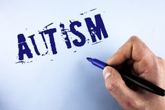 Handwriting text Autism. Concept meaning Autism Awareness conducted by social committee around the globe written by Man on plain b. Handwriting text Autism Stock Images