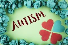 Handwriting text Autism. Concept meaning Autism Awareness conducted by social committee around the globe written on plain backgrou. Handwriting text Autism Stock Images