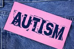 Handwriting text Autism. Concept meaning Autism Awareness conducted by social committee around the globe written on Sticky Note Pa. Handwriting text Autism Stock Photo