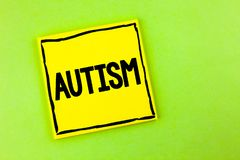 Handwriting text Autism. Concept meaning Autism Awareness conducted by social committee around the globe written on Yellow Sticky. Handwriting text Autism Stock Photography