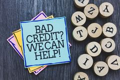 Handwriting text Bad Credit question We Can Help. Concept meaning Borrower with high risk Debts Financial Black wooden