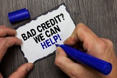 Handwriting text Bad Credit question We Can Help. Concept meaning Borrower with high risk Debts Financial Gray wooden deck hand ho. Ld black marker written black stock photography