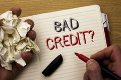 Handwriting text Bad Credit Question. Concept meaning Low Credit Finance Economic Budget Asking Questionaire written by Man on Not. Handwriting text Bad Credit Stock Photo