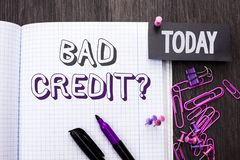 Handwriting text Bad Credit Question. Concept meaning Low Credit Finance Economic Budget Asking Questionaire written on Notebook B. Handwriting text Bad Credit Stock Photography