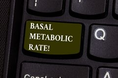 Handwriting text Basal Metabolic Rate. Concept meaning Minimum energy level require to sustain vital function Keyboard. Key Intention to create computer message stock photography