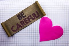 Handwriting text Be Careful. Concept meaning Caution Warning Attention Notice Care Beware Safety Security written on Cardboard Pie. Handwriting text Be Careful Royalty Free Stock Photography