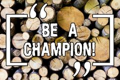 Handwriting text Be A Champion. Concept meaning Triumph in a competition sport the winner of a contest Wooden background. Vintage wood wild message ideas royalty free stock photography