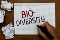 Handwriting text Bio Diversity. Concept meaning Variety of Life Organisms Marine Fauna Ecosystem Habitat Man holding marker notebo. Ok crumpled papers ripped stock photo