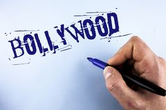 Handwriting text Bollywood. Concept meaning Indian cinema a source of entertainment written by Man on plain background holding Mar. Handwriting text Bollywood stock photos