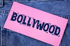 Handwriting text Bollywood. Concept meaning Indian cinema a source of entertainment written on Sticky Note Paper on the Jeans back. Handwriting text Bollywood royalty free stock photo