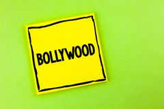 Handwriting text Bollywood. Concept meaning Indian cinema a source of entertainment written on Yellow Sticky Note Paper on the pla. Handwriting text Bollywood royalty free stock photo
