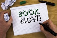 Handwriting text Book Now Motivational Call. Concept meaning Make a reservation in hotel flight accommodation. Concept For Informa. Handwriting text Book Now Royalty Free Stock Image