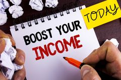 Handwriting text Boost Your Income. Concept meaning improve your payment Freelancing Part time job Improve written by Man on Notep. Handwriting text Boost Your Royalty Free Stock Photography
