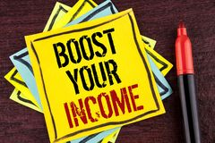 Handwriting text Boost Your Income. Concept meaning improve your payment Freelancing Part time job Improve written on Yellow Stick. Handwriting text Boost Your Royalty Free Stock Photos