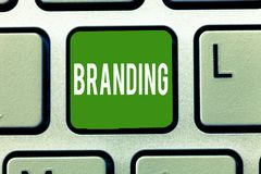 Handwriting text Branding. Concept meaning Assign brand name to something Business marketing strategy.  stock photos