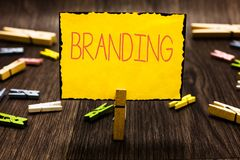 Handwriting text Branding. Concept meaning Assign brand name to something Business marketing strategy Clothespin holding stock photos