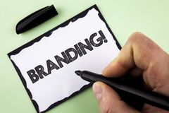 Handwriting text Branding Motivational Call. Concept meaning Creating a unique identity for new startup agencies written by Man on. Handwriting text Branding Royalty Free Stock Images