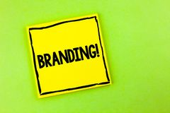 Handwriting text Branding Motivational Call. Concept meaning Creating a unique identity for new startup agencies written on Yellow. Handwriting text Branding Stock Photography