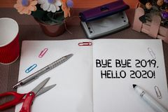 Handwriting text Bye Bye 2019 Hello 2020. Concept meaning saying goodbye to last year and welcoming another good one. Handwriting text Bye Bye 2019 Hello 2020 stock photos
