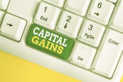 Handwriting text Capital Gains. Concept meaning Bonds Shares Stocks Profit Income Tax Investment Funds White pc keyboard