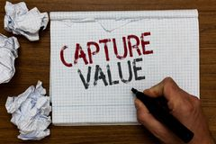 Handwriting text Capture Value. Concept meaning Customer Relationship Satisfy Needs Brand Strength Retention Man holding marker no. Tebook crumpled papers ripped royalty free stock images