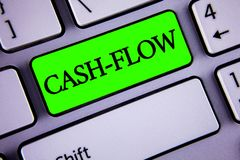 Handwriting text Cash-Flow. Concept meaning Virtual movement of money by company finance department statistics written on Green Ke. Handwriting text Cash-Flow Stock Photo
